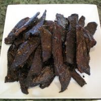 Hawaiian Beef Jerky    What you NEED:  1 lb flank steak  1 T sugar    6 T soy sauce   1 finger ginger (about the size of a thumb) pounded to release flavor   1 clove garlic crushed    1 T Sriracha hot chili sauce (found in Asian markets)    1 t chili flakes