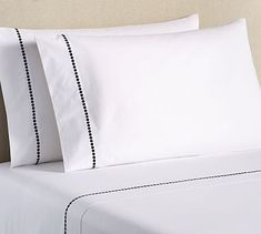 A lustrous row of silky smooth satin-stitched pearls dresses the border of our classic white sheet set woven of organic cotton. Made with a much smaller environmental impact than traditional cotton, you can rest easier with organic. Luxury Sheets, Percale Sheets, Bed Sheets, White Sheets, Cotton Sheet Sets, Classic White, Pottery Barn, Organic Cotton, Pillow Cases