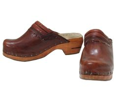 70s -Connie- Womens brown smooth leather and wooden soled clogs with two piece uppers, ribbed padded vamp insert with laced detail, uppers attached to wooden platform soles with small nails, 2inch grooved wooden heels, and ribbed vinyl heel and sole pads (some overall light wear and soiling)