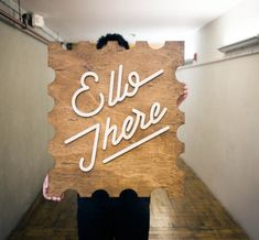 natural wood sign with white artwork