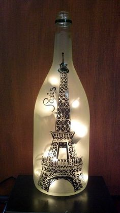 Eiffel Tower, Paris, Recycled Wine Bottle Lamp light This listing is for one Bottle Lamp with lights. This lamp is made out of a recycled wine bottle. The vinyl pictured is in black (other colors Old Wine Bottles, Recycled Wine Bottles, Wine Bottle Art, Wine Bottle Crafts, Glass Bottles, Beer Bottle, Decorative Wine Bottles, Decorative Items, Paris Room Decor