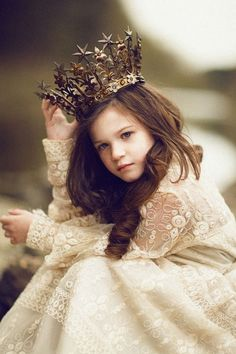 *J   learning...to wear the crown