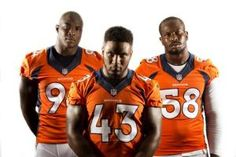 The Denver Broncos' DeMarcus Ware, T.J. Ward and Von Miller pose at Dove Valley on Aug. 14, 2014.-- #ProFootballDenverBroncos