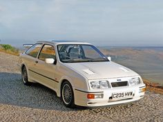 1986 Ford Sierra RS Cosworth Powered by a turbocharged and fuel-injected four good for more than 200 horsepower, the Sierra RS Cosworth focused on pioneering aerodynamics for high-speed stability. Ford Rs, Car Ford, Bmw, Audi, Ford Sierra, Retro Cars, Vintage Cars, Aston Martin, Volvo