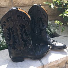 """Justin Cowgirl Boots PRELOVED Black Justin lizard 🐉 cowgirl boots with beautiful design.They were given to me by the body double of a well-known blondie  who had leading roles in Dynasty, TJ Hooker, and Melrose Place. I'm living on a prayer that these boots find a new home with a fabulous Posher💕 - these boots are 11"""" tall with a heel of 1.5"""". Made to last, cowgirl tough 👌🏼PLEASE SEE PHOTOS FOR THE ADVENTURES THESE BOOTS HAVE ENCOUNTERED. Justin Boots Shoes Ankle Boots & Booties"""