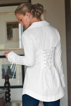 "I have this blouse and it is of the highest quality fabric and craftsmanship. Crisp, cotton blouse with ""corselette"" details on the back & sleeves.  Double-layered collar.  Wear as is in white or black or add a few details with some lace or by changing the lacing to ribbons or suede lacing."