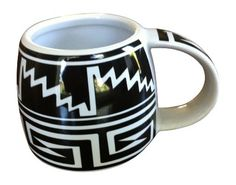 The Mesa Verde Cliff Dweller 12 Oz. Mug channels pottery history with bow tie and stair step patterns inspired by cliff-dwelling Mesa Verde (Anasazi) and Mimbres designs. Perfect for coffee, tea, and more!