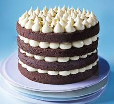 Jo Wheatley's Chocolate layer cake with passion fruit icing. Great British Bake Off winner Jo Wheatley shares her never-fail sponge recipe in this layered cake with a zingy butter icing Bbc Good Food Recipes, Fruit Recipes, Sweet Recipes, Baking Recipes, Cake Recipes, Dessert Recipes, Slow Cooker Desserts, Great British Bake Off, Köstliche Desserts