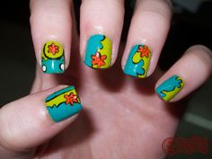 """The Daily Nail: Pop Culture Giveaway! Day 2.""  My answer is I am not sure about a phrase, unless it's 'Scooby Dooby Doo where are you, we got some work to do now... Scooby Dooby Doo where are you, we got some work for you now', & the nails' design is from The Scooby Doo ""Mystery Machine"". I Ruff Scooby!!!!! That's my best guess."