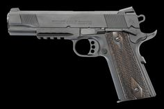 Colt Rail Gun - 1911 45 with a Picatinny rail for a tactical light.  New issue sidearm to elite USMC troops.