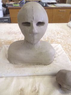 Nose structure added and eye sockets carved out. Beginning to smooth surface