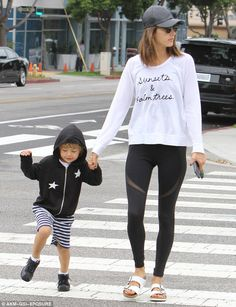 Mother and son moment: Alessandra Ambrosio sizzled in skin-tight leggings when she took her four-year-old son Noah to school in Los Angeles on Monday