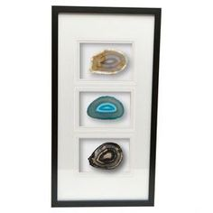 """Add a natural touch to your entryway or master suite with this organic-chic wall decor, featuring a slice of agate displayed under glass and highlighted by a black frame.  Product: Wall decor Construction Material: Wood, glass and agateColor: Black frameFeatures: HandmadeDimensions: 24"""" H x 12"""" W x 2"""" D Note: Agate varies in size"""