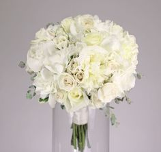 white beauty: a classic design of white and ivory peonies, roses, spray roses and hydrangea with gunnii eucalyptus.