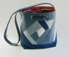 This is a medium size drawstring bucket bag, shoulder bag, handbag, purse. A variety of upcycled recycled repurposed denim blue jeans and cotton fabric was used to create this unique Crazy Quilt bag. This medium size bag is perfect for carrying all your daily must haves comfortably. Add a favorite pin to coordinate with your outfit. The front and back exterior was created and uniquely pieced together Crazy Quilt patchwork style with a variety of upcycled recycled denim blue jeans. Each side…