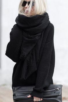 Knitwear Fashion 2014: Figtny is wearing a heavy knit black sweater from Montpellier