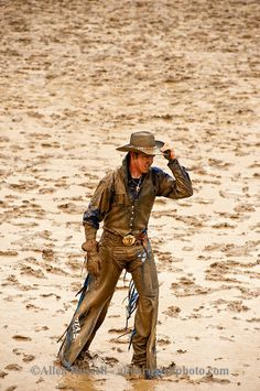 Miles City Bucking Horse Sale, Bareback rider after buck off in mud, Montana