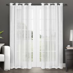 Give your windows a stylish update with the Penny Grommet Top 96-inch Sheer Curtain Panel Pair. These sheer curtains add a hint of contemporary elegance to any room, and allow plenty of natural light to filter in.