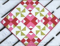 """Sweetie Pie Pinwheels couldn't be sweeter! Shared by Brenda Karls-Nace of Blue Ribbon Designs. This table topper can be easily made using the @Accu GO! Qube 8"""" Mix & Match Block."""