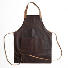 CAPPS Leather Work Apron In Baldwin Oak, Moore & Giles: This vintage-inspired leather apron not only pays tribute to the artisans and craftsmen of the past but features a variety of well thought out details that make it fully functional for life today. With wear and with age, it will darken naturally and develop a rich, polished patina.