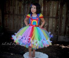 This Rainbow Bright Inspired Tutu Dress is made to order especially for those of you who Love the 80s. This dress is knee length. ***2 Matching Hairbows*** https://www.etsy.com/listing/293559521/hair-bow-set-rainbow-brite-hair-bows The model is showing a tea length dress. If a