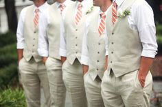 No jackets, just rolled up sleeves and vests. Soooo sexy. I like this! Esp. for an outdoor June wedding when it might get hot! ... Also really like their ties :)