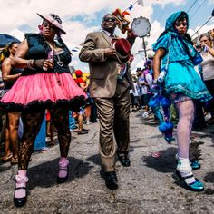 At New Orleans jazz funerals, the band is followed by the second line, an open parade. Here, Baby Doll dancers honor musician Uncle Lionel Batiste, keeping the tradition of street events kicking for over a century.