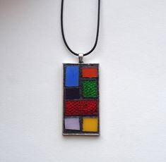 "Gorgeous rainbow color block Mondrian style stained glass mosaic pendant. Silver-plated base with 18"" waxed cotton cord. Hand created by NiagaraGlassMosaics on Etsy"