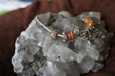 This is aBeautiful Silver tone Chain Bracelet, with interchangeable Orange Glass