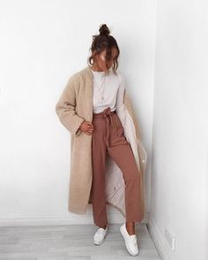 Without any doubt, you'll look outrageously gorgeous in a camel fur coat and brown wide leg pants. Dress down this getup with white leather slip-on sneakers.   Shop this look on Lookastic: https://lookastic.com/women/looks/fur-coat-long-sleeve-t-shirt-wide-leg-pants/23508   — White Long Sleeve T-shirt  — Gold Pendant  — Tan Fur Coat  — Brown Wide Leg Pants  — White Leather Slip-on Sneakers