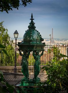 Beautiful public drinking fountain on the Montmartre butte in central Paris, France. Wallace fountains are public drinking fountains designed by Charles-Auguste Lebourg that appear in the form of small cast-iron sculptures scattered throughout the city o Paris France, Paris 3, I Love Paris, Montmartre Paris, Paris Green, Paris Travel, France Travel, Tour Eiffel, Monuments