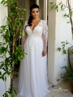 9028c02d6b2 Stunning romantic plus size bridal gown with long sleeves and tulle skirt.  Tracie. Studio · Wedding Dresses ...