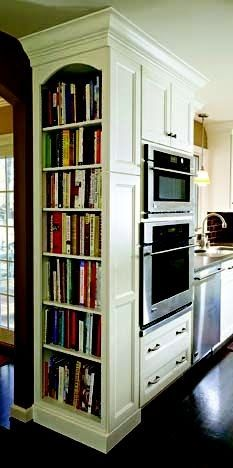 Passing by cookbook-lined shelves is a gorgeous way to enter a kitchen--and a smart storage solution.