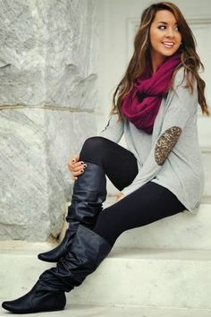 light grey long sleeve shirt, black leggings, tall black leather boots, and a wine red wool infinity scarf.