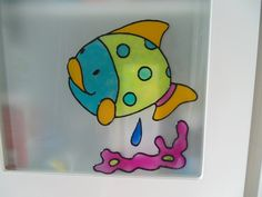 Decorate your bathroom tiles, windows, or mirrors with this vibrant colored Fish window cling. Comes with an accompanying pink coral and a little blue water drop.    Clings... #etsysocial