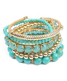 Take a look at this Teal & Goldtone Medley Stretch Bracelet Set today!