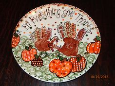 Thanksgiving hand print plate.  Turkeys