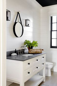 Modern farmhouse bathroom with ship lap walls, white vanity, black counter and natural fiber accents. Rustic Bathroom Vanities, Modern Farmhouse Bathroom, Bathroom Renos, Rustic Farmhouse, Master Bathroom, Bathroom Black, Remodel Bathroom, Shiplap Bathroom, Budget Bathroom