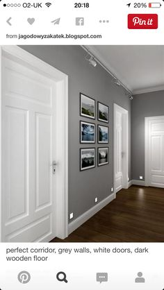 Love the combination of grey walls with white doorframe and door on dark laminated floor.