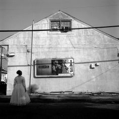 Carrie Mae Weems, Untitled (Woman Standing Before Commercial Billboard), 2003.