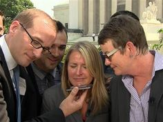 The California couples who challenged Prop. 8 -- Kris Perry and Sandy Stier, and Jeff Zarrillo and Paul Katami -- were clearly delighted to be speaking about this morning's Supreme Court rulings, but their MSNBC interview was interrupted this morning. President Obama wanted to extend his personal congratulations.