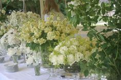 Google Image Result for http://www.amandaaustinflowers.co.uk/images/weddings/wedding-tables/large/clients_own_vases_filled_with_stocks,_roses,_sweetpeas,_and_scabious_flowers_en-masse.jpg