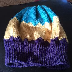 This a simple hat that can use up those part balls of 8 ply you have left over. Get creative with your colour combinations.