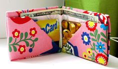 Bee-a-ba: Fabric Origami Wallet --- she used stiffened fabric. Could use sturdy paper or maybe do some recycled wrappers on interfacing or something.