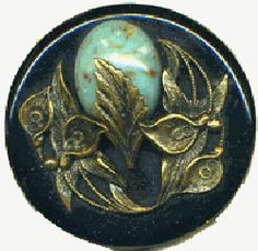 This Bakelite button has an Amino jewel as the focal in the brass foliage.