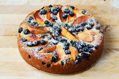 Peach and Blueberry Greek Yogurt Cake is so pretty and the colored fruit is so tasty. A moist cake with Greek yogurt, butter and eggs. Topped with powdered sugar. Blueberry Yogurt Cake, Greek Yogurt Cake, Greek Yogurt Recipes, Yogurt Dessert, Types Of Desserts, Just Desserts, Delicious Desserts, Yummy Food, Baking Recipes