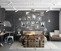 The charcoal gray walls are lifted by the presence of a bright white ceiling, and a large cream area rug sprawling from beneath the end of the bed, and the vintage style chest at it's foot.