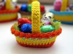 "Crochet Pattern ""Easter basket"" Material: yarn scraps Crochet hook 3mm or 2mm sewing needles Abbreviations: st-stitch sc-single crochet hdc- half double crochet dc- double crochet sl st- slip stitch ch-chain Round 1 Chai"