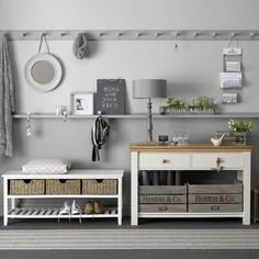 I like this very long row of hooks and picture ledge. Flexible. Ledge is in the way for hanging coats.  (10 Livable & Functional Spaces {Organizational Style} - The Inspired Room)