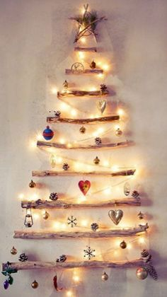 wall Christmas tree made from natural branches   |   via Leticia Dias